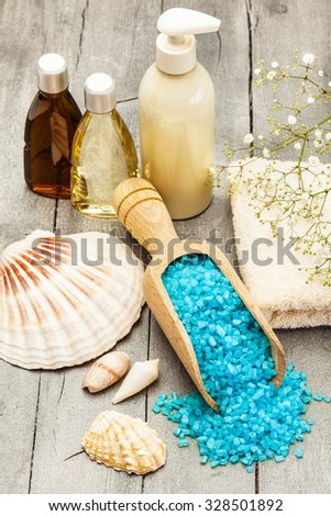 Photo of spa products over wooden table