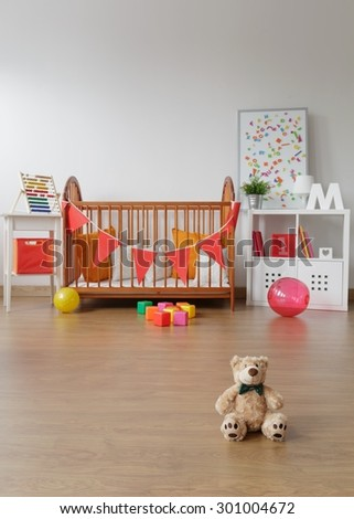 Photo of spacious child room interior with toys - stock photo