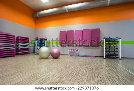 Photo of spacious colorful exercise room - stock photo