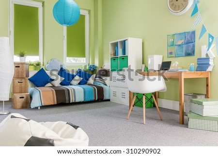 Photo of spacious modern design green boy room - stock photo