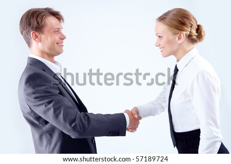 Photo of successful business partners handshaking after striking great deal - stock photo