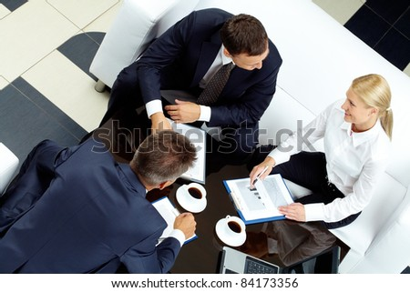 Photo of successful partners discussing business ideas at meeting