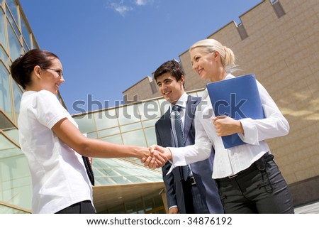Photo of successful partners handshaking after striking deal at meeting - stock photo