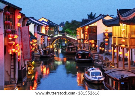 Photo of Suzhou old town in the evening, stylized and filtered to look like an oil painting  - a canal, boats, historic houses and chinese lanterns. - stock photo
