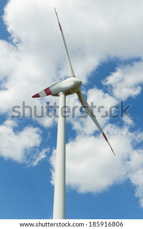 Photo of tall windmill on the plains - stock photo