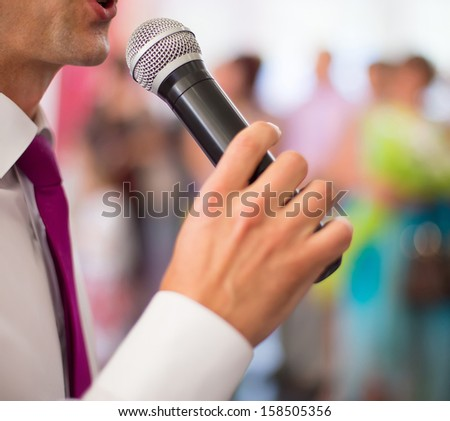 photo of the announcer speaks into a microphone - stock photo