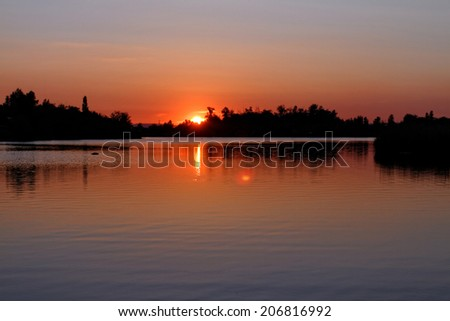Photo of the beautiful sunset above the water