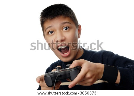 Photo of the boy plaiyng in computer game with joystick - stock photo