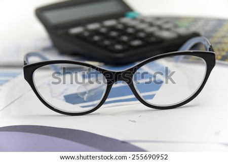 Photo of the Businessman analyzing investment charts with calculator and laptop