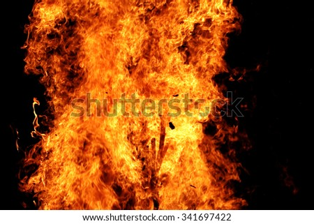 Photo of the campfire flames in the dark - stock photo