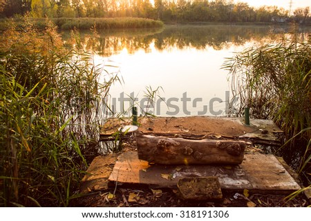 Photo of the fishing dock and water reed - stock photo