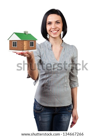 Photo of the girl with a house in a hand