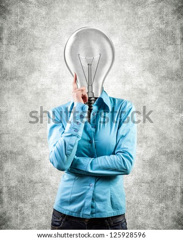 Photo of the girl with lightbulb instead of a head - stock photo