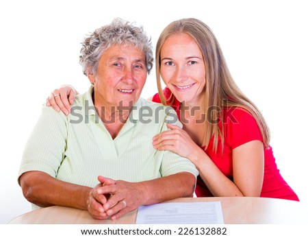 Photo of the happy elderly woman with her daughter - stock photo