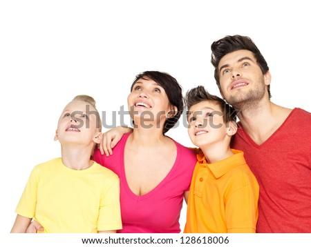 Photo of the happy young family with two children looking up isolated on white background - stock photo