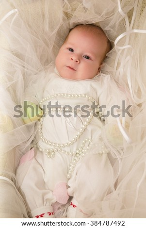 photo of The little baby (girl) in a basket