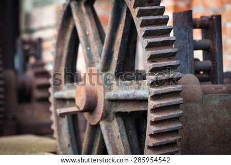 Photo of the old rusty gears, machinery parts.