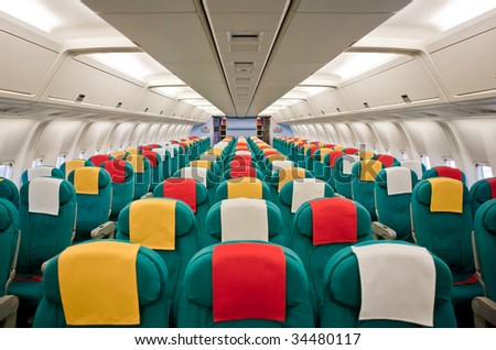 Photo of the passenger cabin of a commercial airliner. - stock photo