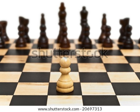 Photo of the pawn at the  checkerboard - stock photo
