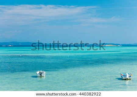 photo of the sea and boats on the sky background