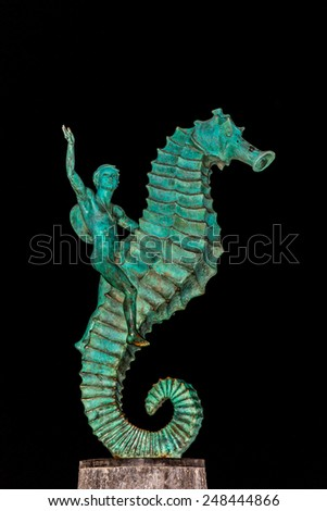 """Photo of the seahorse statue otherwise known as """"Caballeo del Mar"""" in Puerto Vallarta Mexico. This public statue is one of Puerto Vallarta's most famous landmarks. - stock photo"""