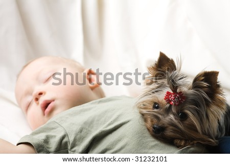 Photo of the sleeping baby with a terrier - stock photo