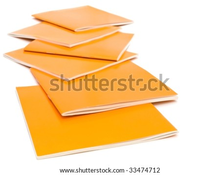 photo of the some orange brochures against the white background - stock photo