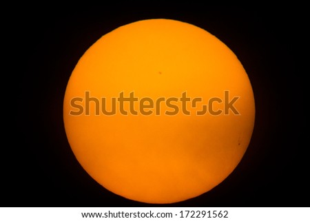 Photo of the sun with an especial leaf. In the photo we can see some sunspots - stock photo