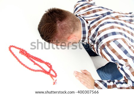 Photo of the Young Muslim Man Is Praying - stock photo