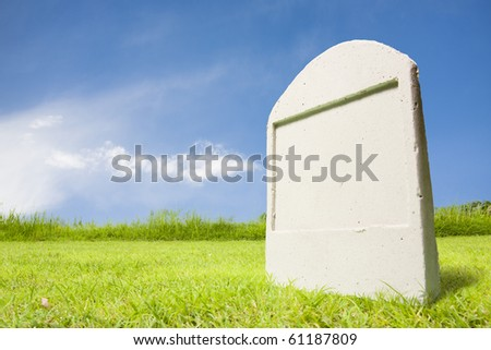 photo of tombstone at day - stock photo