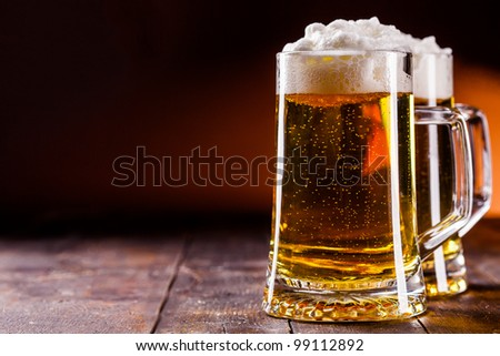photo of traditional german beer glass on wooden table - stock photo