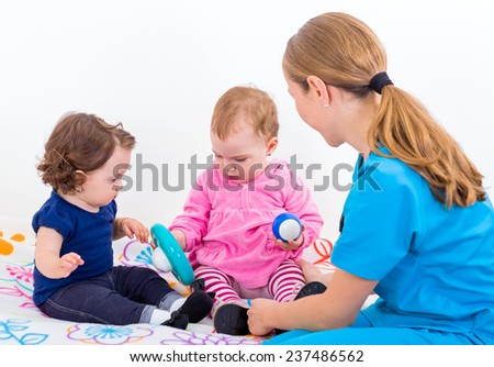 Photo of two adorable baby and the doctor - stock photo