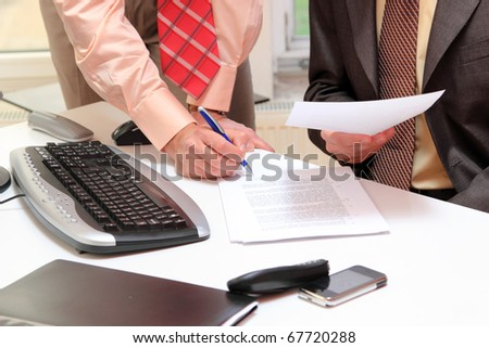 Photo of two business people at the signing contracts