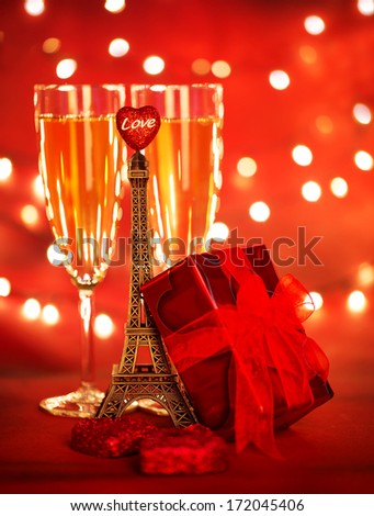 Photo of two champagne glass with red gift box and Eiffel tower, honeymoon vacation, romantic date, Valentine day, travel to Europe, sparkling wine, holiday dinner, luxury lifestyle, love concept - stock photo