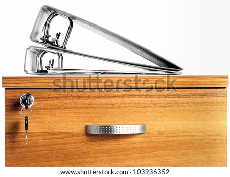 photo of two folders laying on top of secured cabinet - stock photo