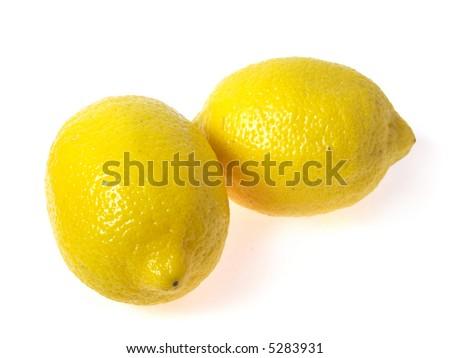 Photo of two lemons on white background - stock photo