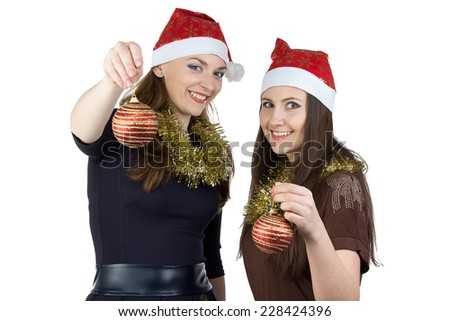 Photo of two young women with christmas balls on white background