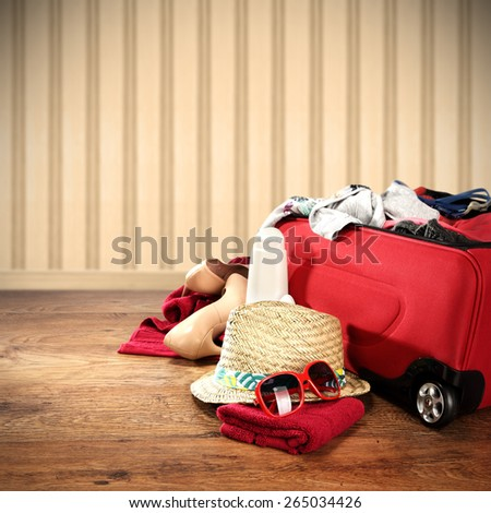 photo of vacation time and red suitcase  - stock photo