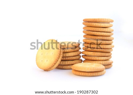Photo of vanilla flavored cream sandwich crackers isolated on white - stock photo