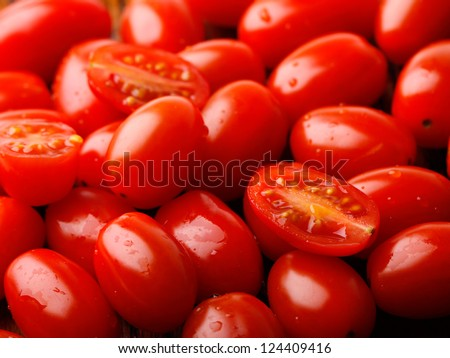 photo of very fresh tomatoes presented on the wood - stock photo