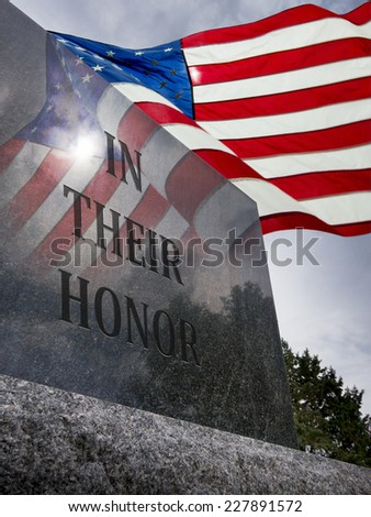 Photo of Veteran's Day or Memorial Day With United States Flag flying overhead and reflected in granite monument. - stock photo