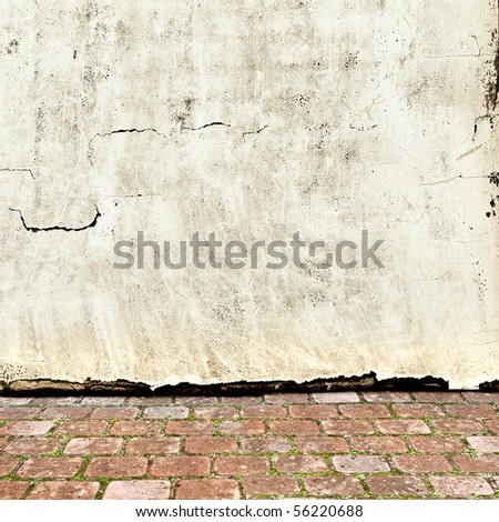 photo of vintage exterior with brick floor and grunge wall - stock photo