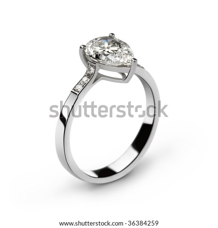 Photo of white gold ring with white diamonds and one big pear-shaped diamond