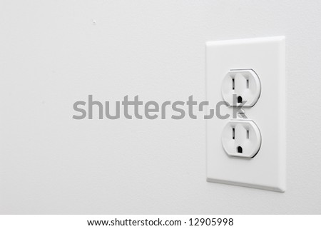 Photo of white outlet with wall space for copy