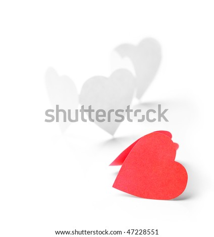 Photo of white paper hearts in chain with one of them red being on the foreground. - stock photo