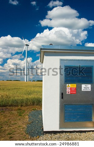 Photo of Wind power installation in sunny day and trafo station - stock photo