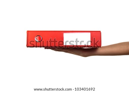 Photo of woman hand with red folder laying on it