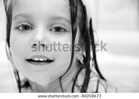 photo of 4 years old girl having bubble bath - stock photo