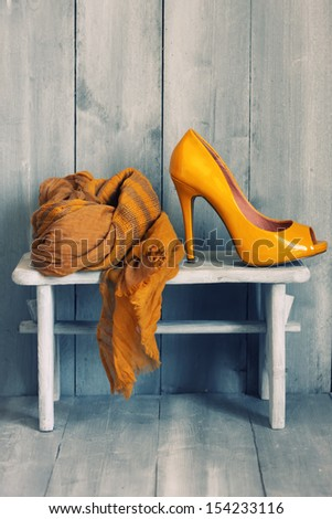 Photo of yellow shoes and scarf - stock photo