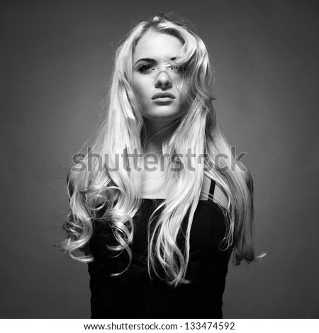 Photo of young beautiful lady with magnificent blond hair - stock photo